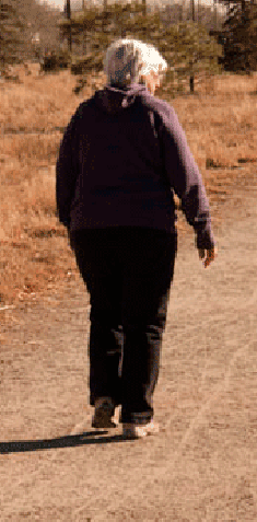 woman walking on a dusty road